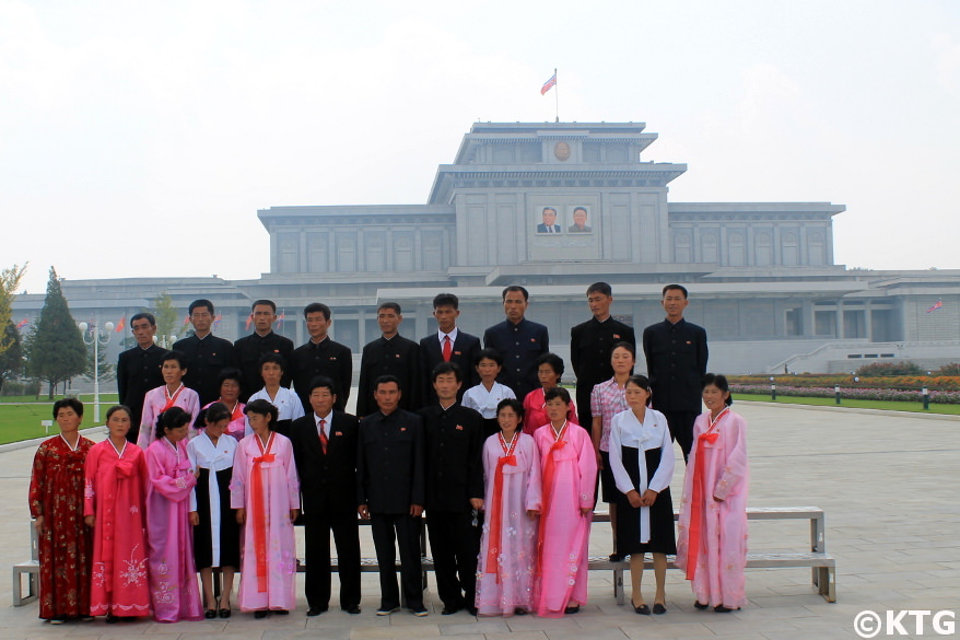 North Koreans taking a picture in the park at the Kumsusan Palace of the Sun in Pyongan capital of North Korea, DPRK. Trip arranged by KTG Tours
