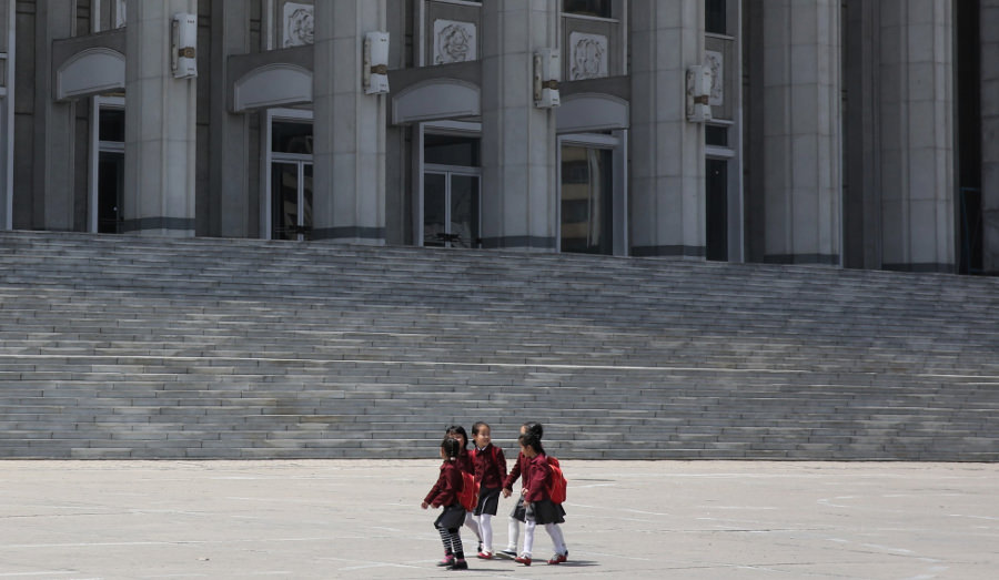 North Korean children marching in a street rally in Hamhung