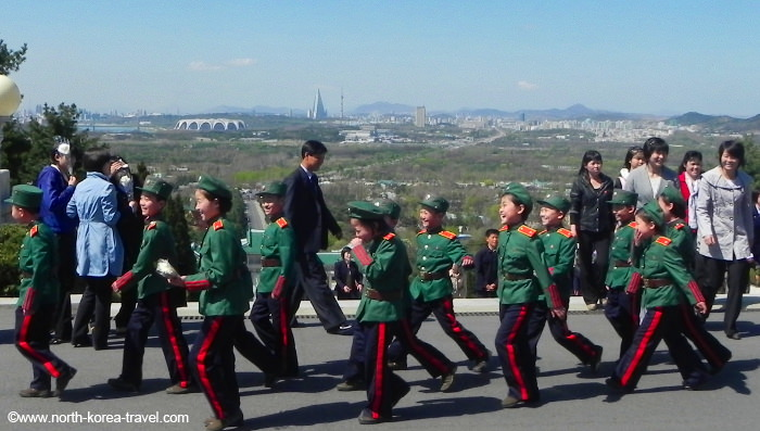 Children at the Revolutionary Martyr's Cemetery in the outskirts of Pyongyang, capital of North Korea