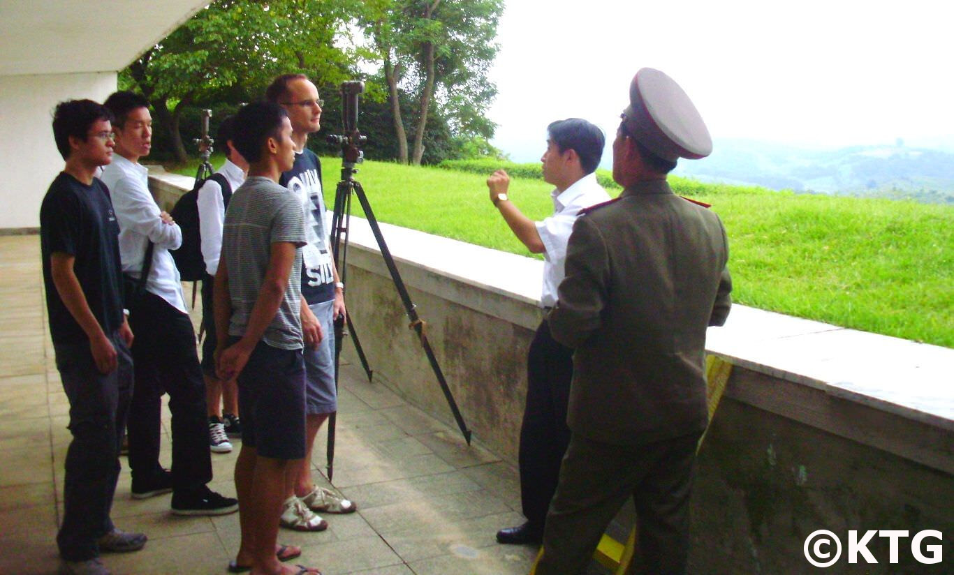 North Korea officer explains to KTG travellers where the Concrete Wall across the DMZ in South Korea is. The DPRK Colonel answers any questions we may have