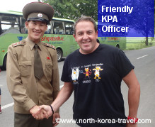 DPRK soldier shaking hands with a traveller in the ZDM, DPRK