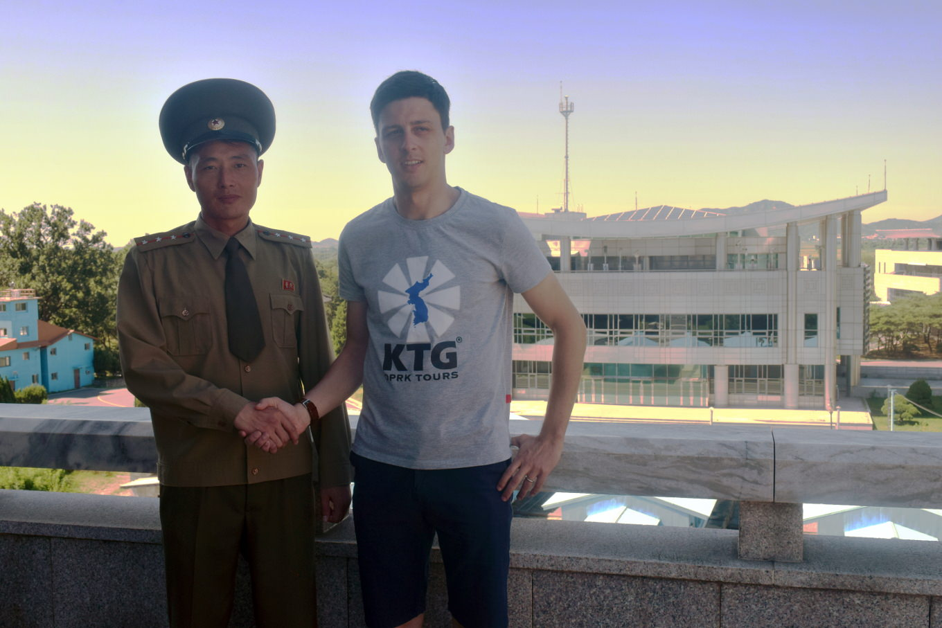 KTG staff member at the DMZ (Panmunjom) with a North Korean soldier, (DPRK)
