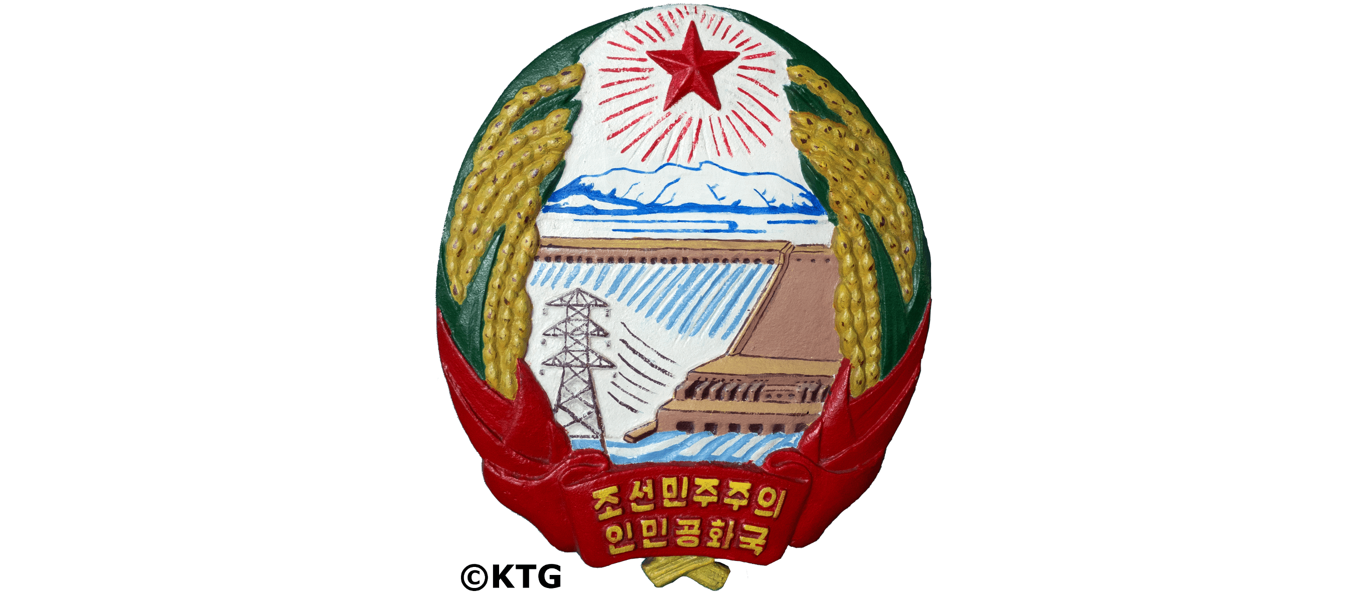 DPRK Natonional Emblem. The National Emblem of North Korea consists of a red star, Mount Paekdu, a dam, electric towers and cornfields. Picture taken by KTG