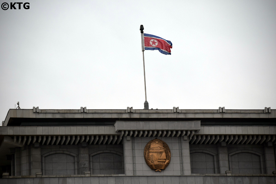 North Korean flag and DPRK emblem at the Kumsusan Memorial Palace in Pyongyang, North Korea, DPRK. Trip arranged by KTG Tours