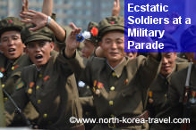 North Korean soldiers greet enthusiastically at a military parade in Pyongyang, DPRK