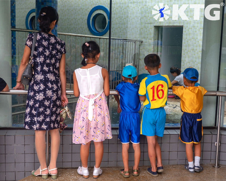 North Korean family at the Pyongyang central zoo in North Korea. Welcome to the Korea central zoo! Tour arranged by KTG Tours
