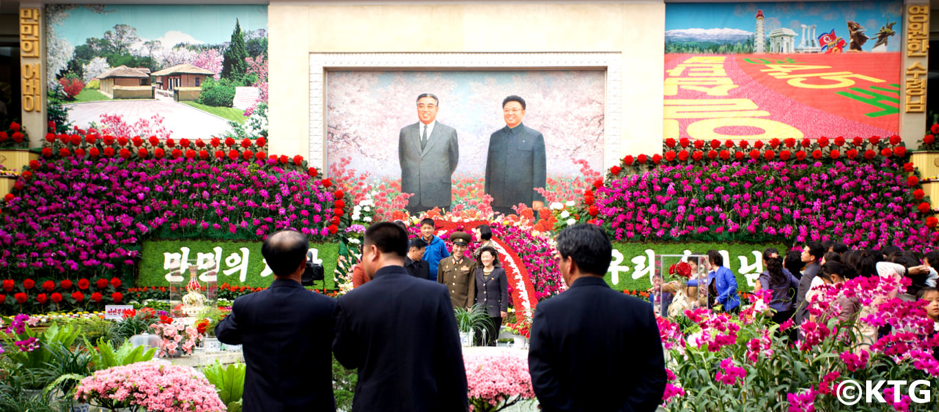 Family gathering at the KimilSungia and Kimjongilia Flower Exhibition Hall on 15th April; the Day of the Sun
