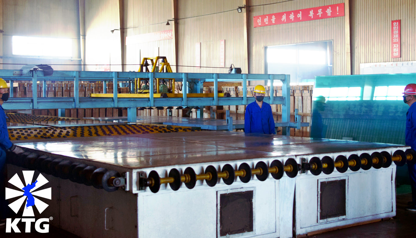 Heavy industry in North Korea; workers at the Taen Friendship Glass Manufacturing Factory near Nampo city. Trip arranged by KTG Tours