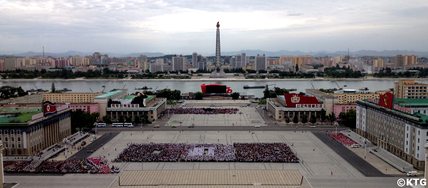 Kim Il Sung Square in Pyongyang as seen from the Grand People's Study House balcony. You can see the Juche Tower in the background. Picture taken by KTG Tours