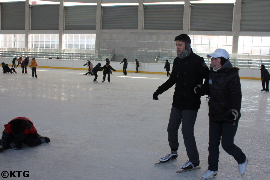KTG Tours staff member ice skating in Pyongyang capital city of North Korea, DPRK