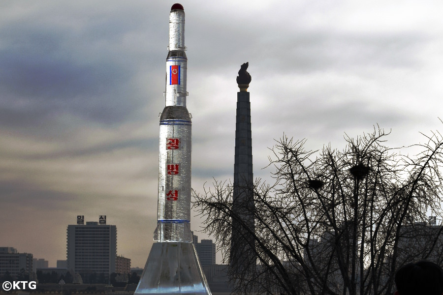 North Korean Ice Rocket sculpture in Kim Il Sung Square with the Juche Tower in the background