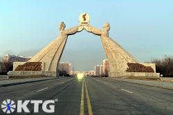 Arch of reunification seen from the middle of the reunification highway, Tongil highway, in Pyongyang, capital of North Korea, DPRK