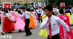 Mass Dances in Pyongyang to celebrate National Day in the DPRK ie North Korea. This is by the party foundation monuments. Picture taken by KTG Tours