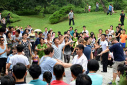 KTG travellers dancing with North Koreans at Moran Park in Pyongyang, North Korea, on Liberation Day