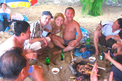 KTG travellers having a drink with North Koreans at Majon beach in North Korea, DPRK