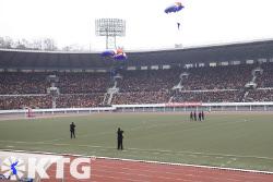 Parachute performance during the Pyongyang marathon at Kim Il Sung Stadium in North Korea (DPRK)
