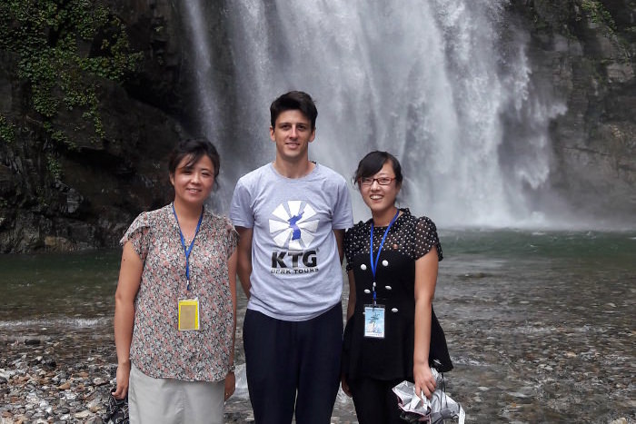 Ullim waterfalls in North Korea. KTG staff member with local North Korean guides