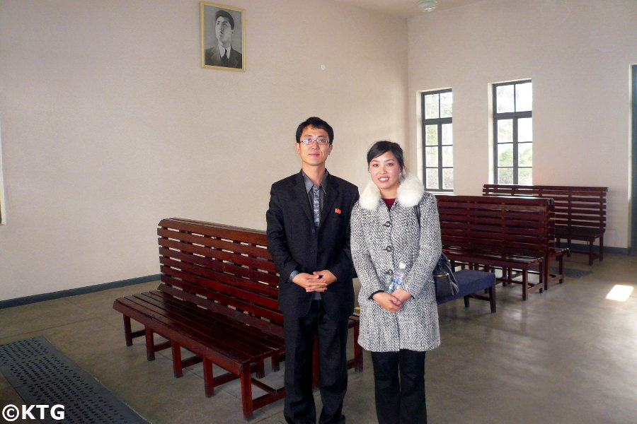 North Korean guides at the Wonsan Train Station Revolutionary site in North Korea, DPRK, with KTG Tours