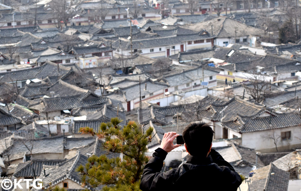 KTG traveller taking a picture of the old part of town of Kaesong, North Korea (DPRK)