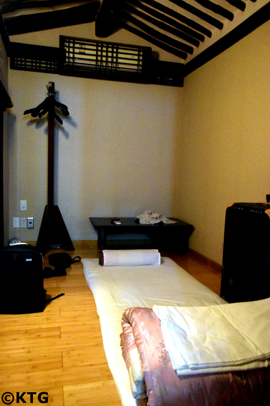 Room at the Minsok Hotel in Kaesong. We sleep on a thick mattress on heated floor. The floor is heated by an ondol system in typical Korean traditional style. Picture taken by KTG Tours