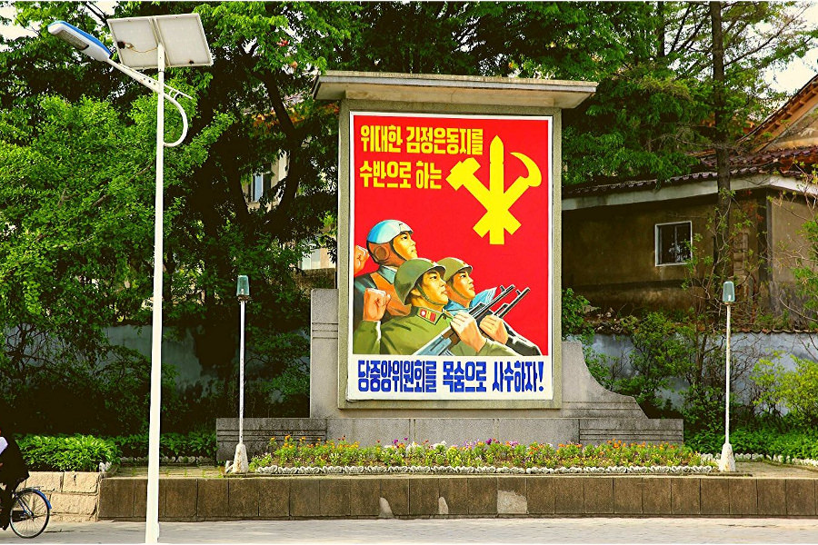 North Korean military propaganda poster in Kaesong city, just across the Minsok Hotel. Visit the DPRK with KTG Tours
