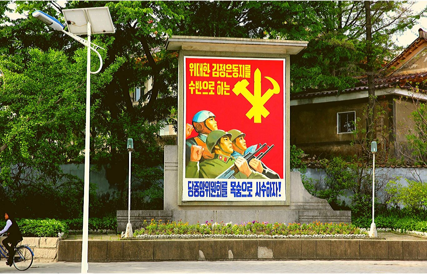 North Korean propaganda poster of soldiers in Kaesong, DPRK. Trip arranged by KTG Tour