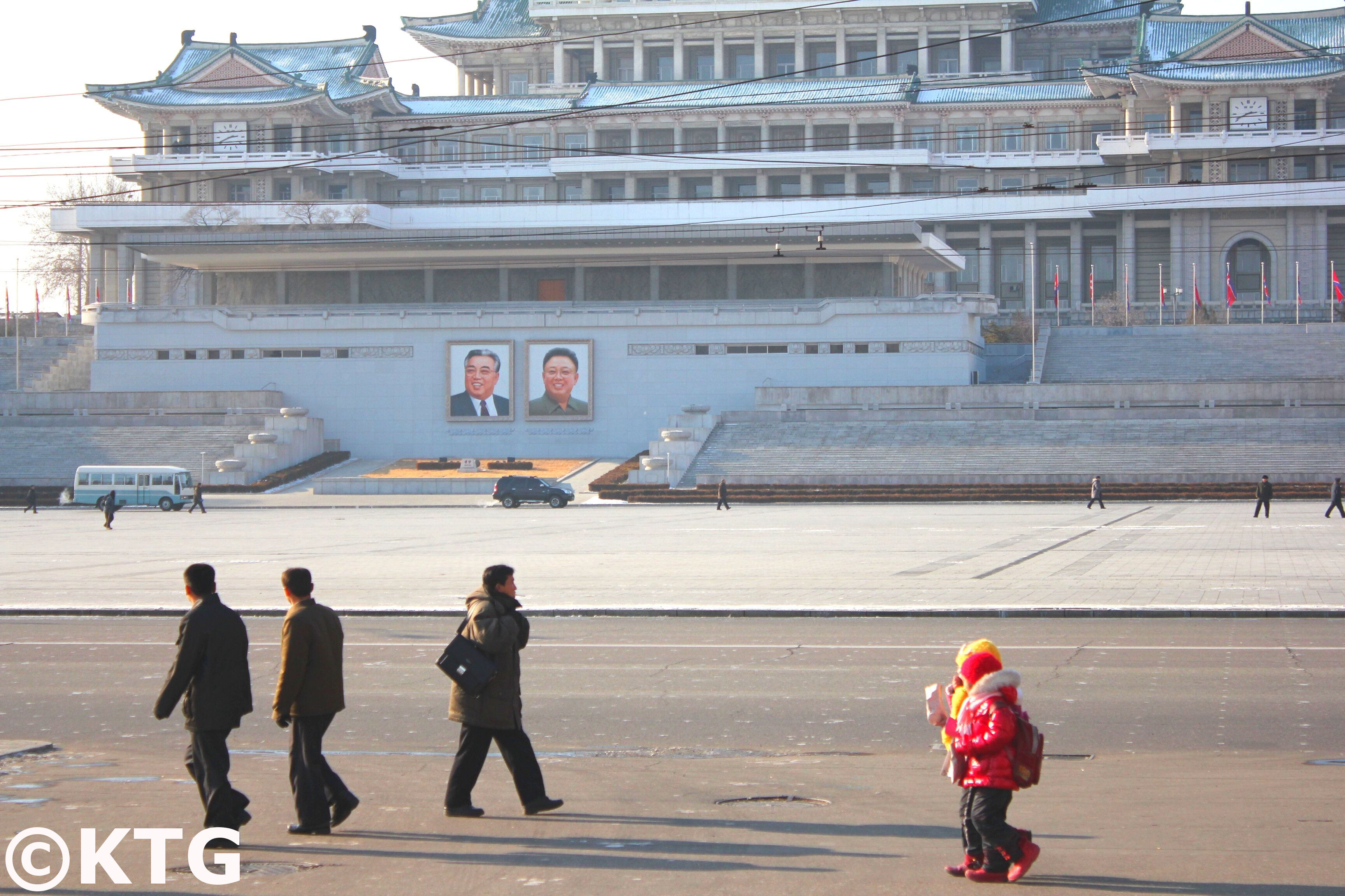 Portraits of leader Kim Jong Il and Kim Il Sung at Kim Il Sung Square in the heart of Pyongang, capital of North Korea (DPRK)