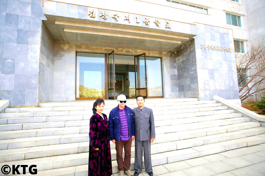 KTG Tours traveller at Kim Jong Suk Number One Middle School in Pyongsong city, capital of South Pyongan province with the school's headmaster and a teacher