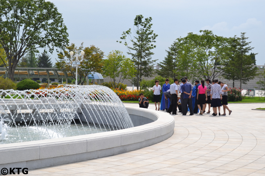 North Korean family by the fountain at the Kumsusan Palace of the Sun in Pyongyang, North Korea (DPRK). Picture taken by KTG