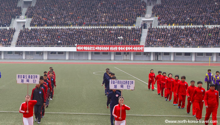 North Korean athletes line up in Kim Il Sung Stadium preparing for the Mangyongdae Prize Marathon aka The Pyongyang Marathon