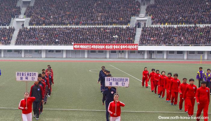 North Korean athletes line up in Kim Il Sung Stadium preparing for the Mangyongdae Prize Marathon aka The Pyongyang Marathon