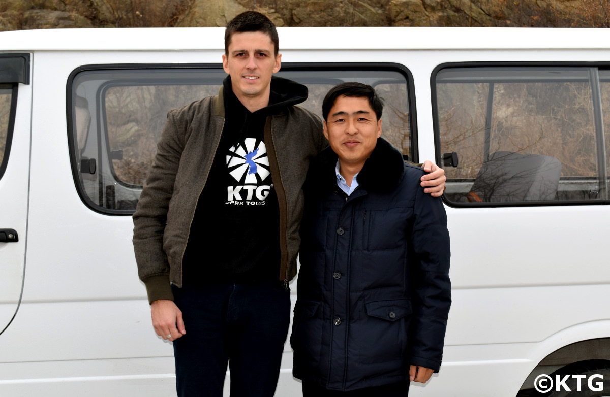 KTG staff member in the special economic zone of Rason in North Korea (DPRK) with local North Korea guide and partner Mr. Kim