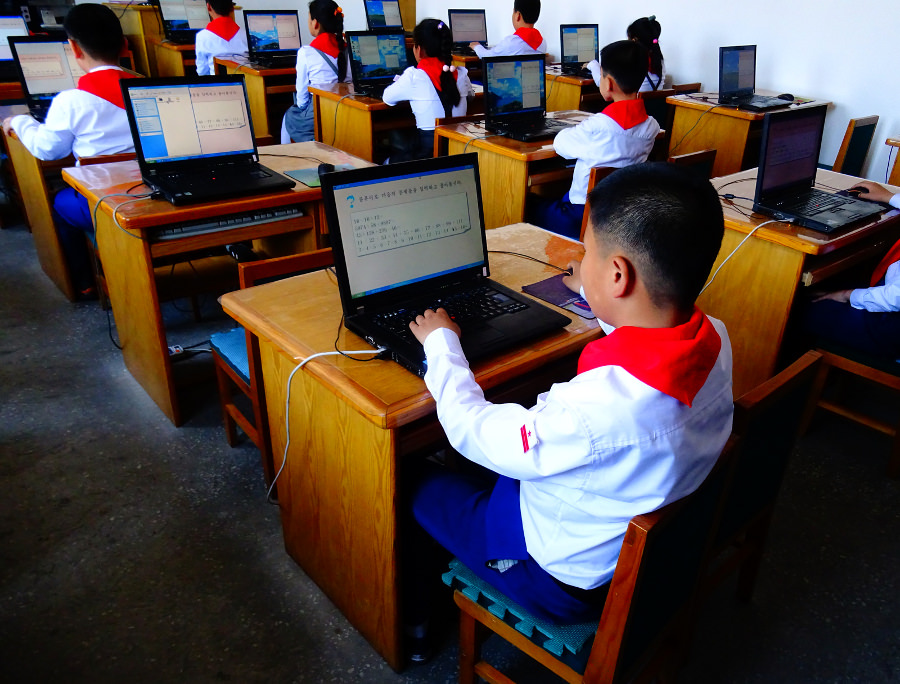 North Korean students on computers at a maths lesson in Dongsuk Primary School in Pyongsong city lining up in the morning before class. This is in South Pyongan province in North Korea, DPRK. Picture taken by KTG Tours