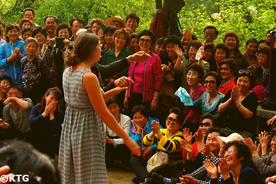KTG Tours traveller dancing with North Koreans on May Day at Moran Park in Pyongyang, capital of North Korea, DPRK