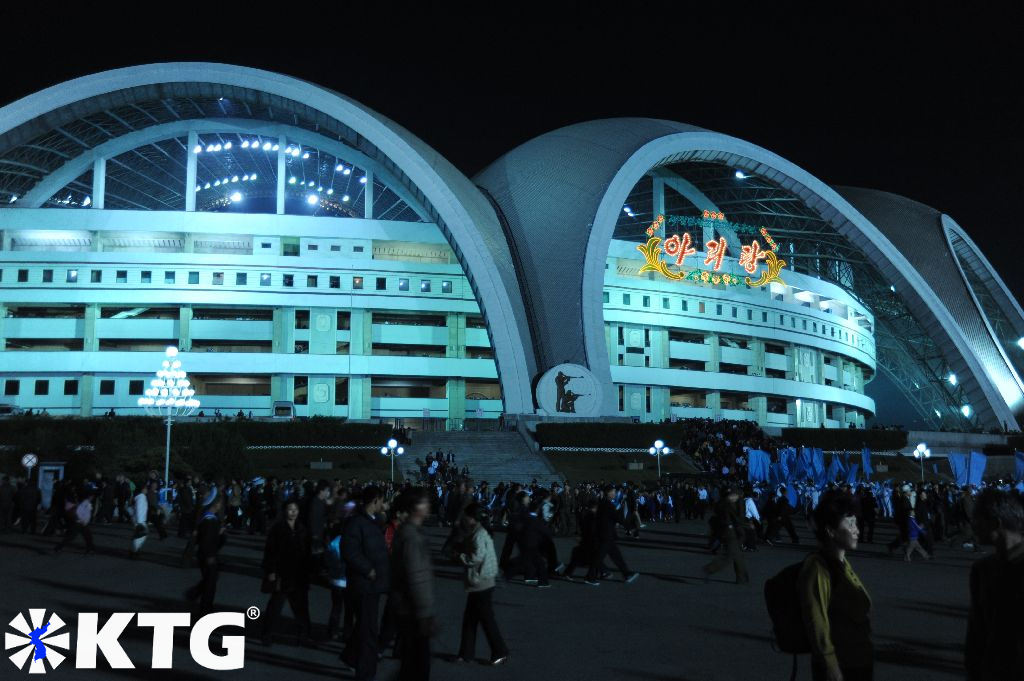 People gathering outside the Rungrado May Day Stadium just before a Mass Games performance, North Korea, DPRK.