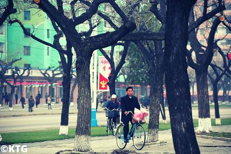 North Koreans riding bikes