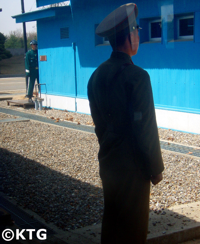 North and South Korean soldiers face each other at the Panmunjom in the DMZ. Trip arranged by KTG Tours