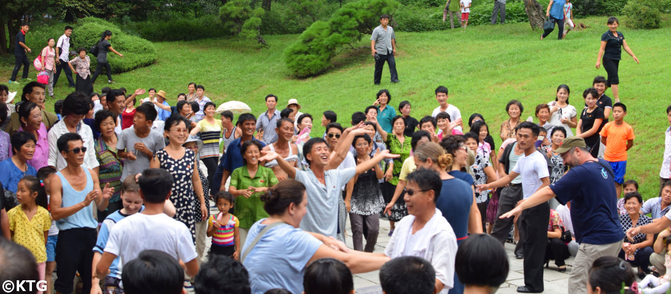 Summer time in North Korea (people dancing in moranbong park in Pyongyang)