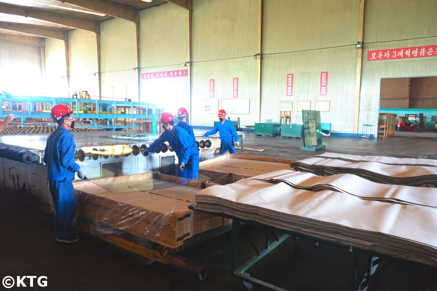 North Korean factory workers at the Tae'an glass manufacturing factory in Nampo, the friendship factory. Picture taken by KTG Tours