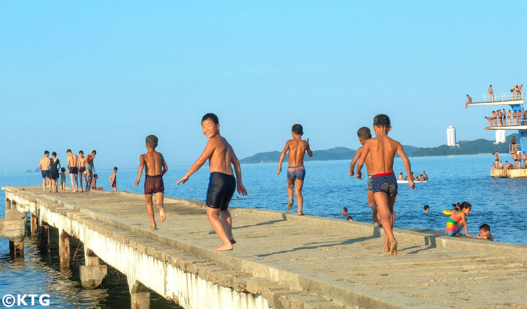 children at the beach in Wonsan in North Korea. DPRK trip arranged by KTG Tours