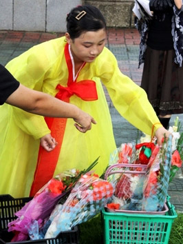 North Korean lady laying flowers