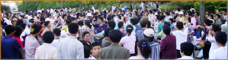North Koreans dancing in Pyongyang