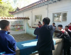 North Koreans in Sariwon playing a shooting game, North Hangh province, North Korea