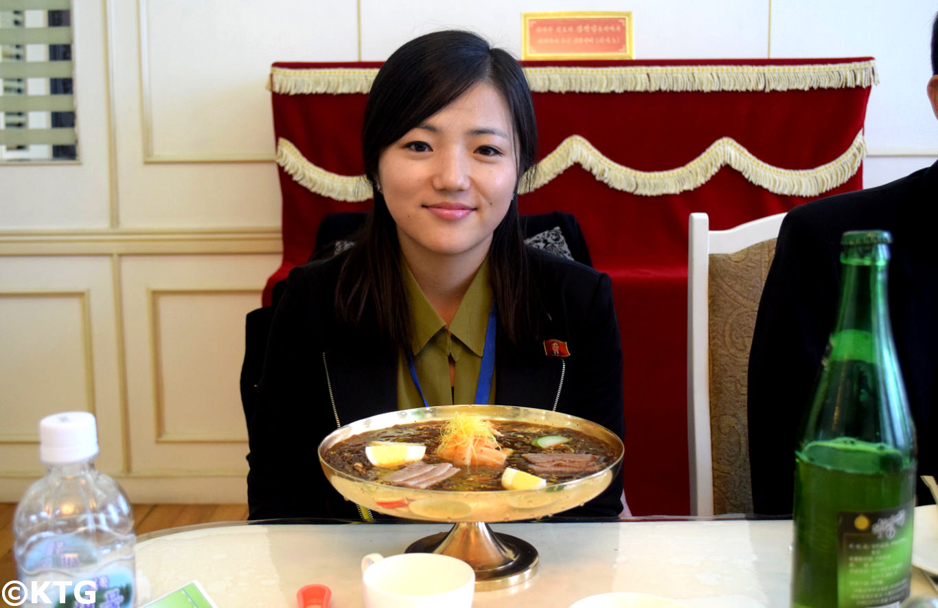 North Korean top guide Kim Song Mi having some Pyongyang cold noodles at the Okryu restaurant in the DPRK