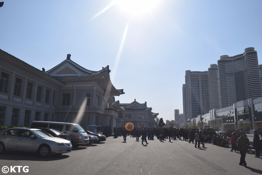 People queuing outside the Okryu restaurant in autumn in Pyongyang, North Korea, DPRK. Picture taken by KTG Tours