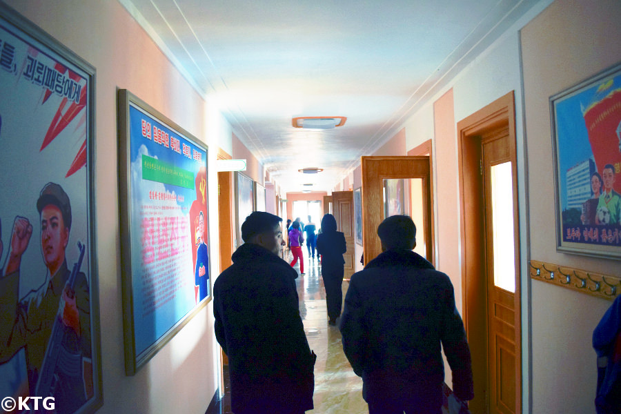 Corridor and North Korean propaganda posters at the Rajin Orphanage in Rason a special economic zone in North Korea, DPRK. Trip arranged by KTG Tours