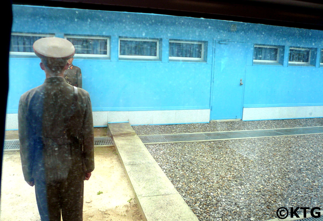 The concrete slab marks the demarcation line in Panmunjom at the DMZ and separates North and South Korea
