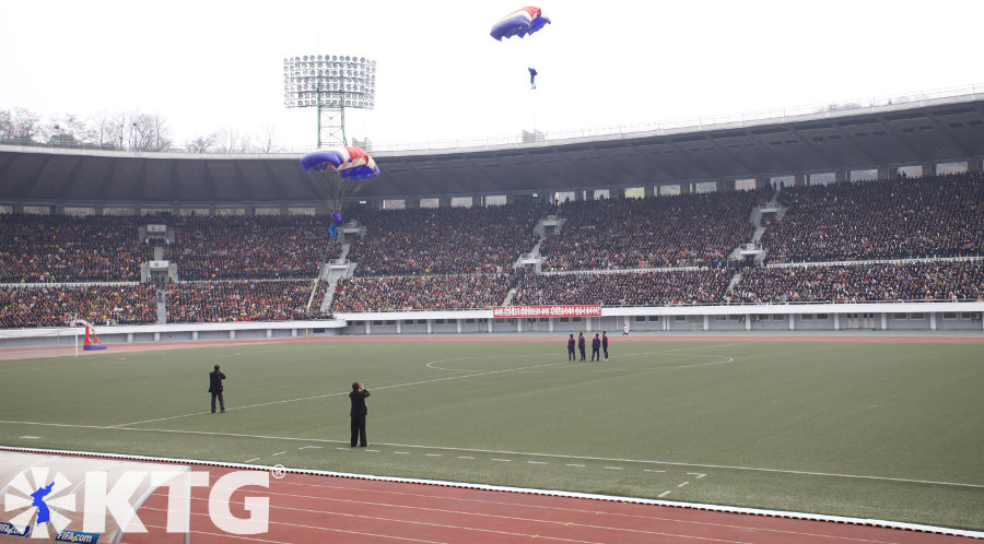 Parachutists landing in Kim Il Sung Stadium in Pyongyang capital of North Korea, DPRK. Picture taken by KTG Tours