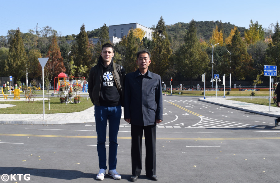 Director of the Pyongyang Children's Traffic Park with Rayco from KTG Tours, North Korea (DPRK)