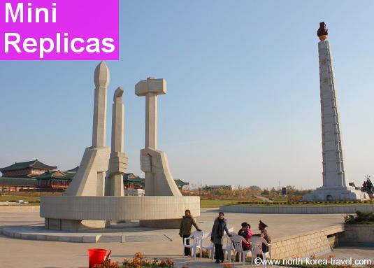 Versiones pequeñas de la Torre Juche y del Monumento de la Fundación de los Partidos de Corea en el Parque Folclórico de Pyongyang, Corea del Norte
